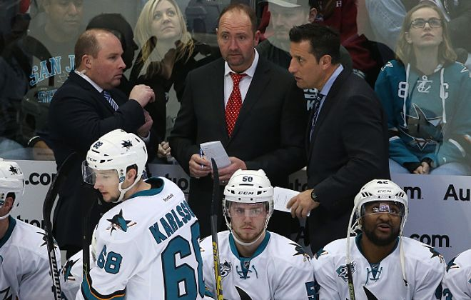 Bob Boughner, right, joined the San Jose staff of Peter DeBoer, middle, in 2015 (Getty Images).