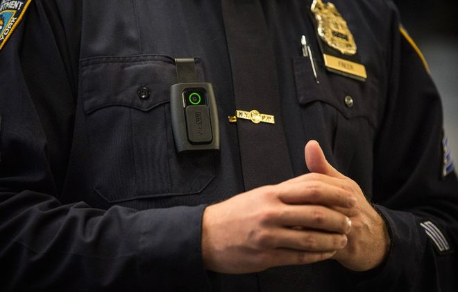 A New York Police officer demonstrates how to use and operate a body camera. (Getty Images)
