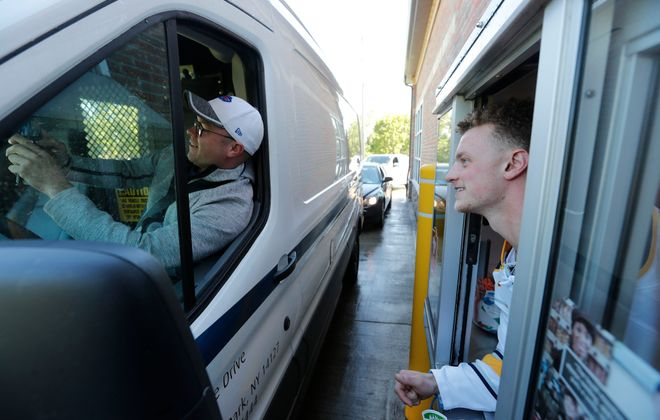 """Jack Eichel, working at a Tim Hortons in Orchard Park during the chain's """"Camp Day"""" fundraiser, spoke with the News during a break in his shift about new GM Jason Botterill and the firings of Dan Bylsma and Tim Murray. (Mark Mulville/Buffalo News)"""