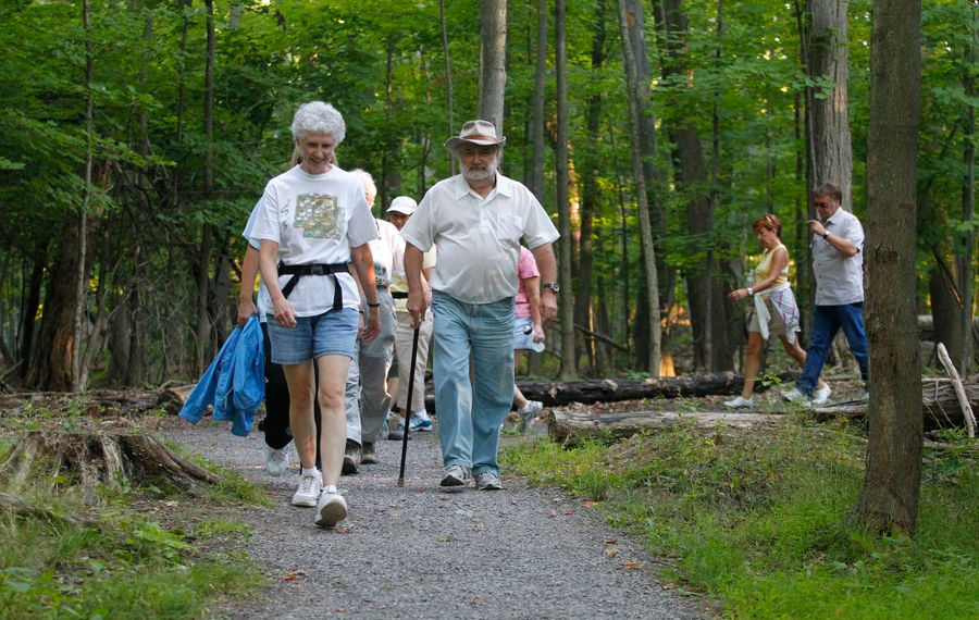 Kathy Foote, of Foothills Trail Club, leads a group of hikers through Stiglmeier Park in Cheektowaga. (John Hickey/News file photo)