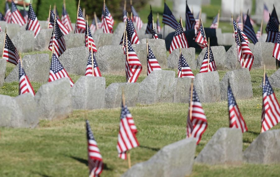 Flags placed on graves provide a moving tribute to the sacrifice of our service men and women. (James P. McCoy/ Buffalo News)