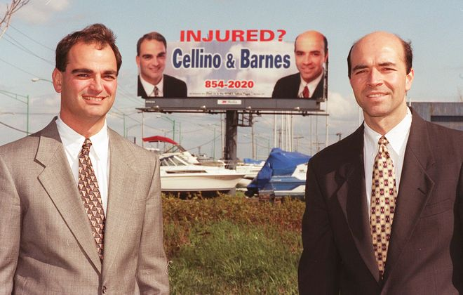 Ross Cellino & Steve Barnes, during happier times in 1997, standing in front of a billboard similar to the one in New York City from which a worker fell. (Sharon Cantillon/News file photo)