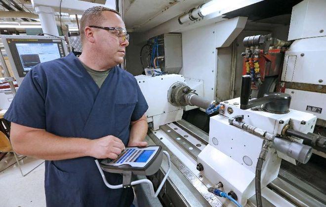 Patrick Barrett, at work in Moog Inc.'s plant in Elma. (Robert Kirkham/Buffalo News)