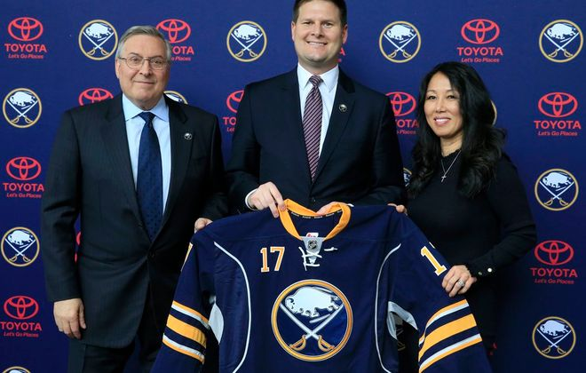 Jason Botterill, center, with Sabres owners Terry and Kim Pegula, is keeping an open mind for coaching interviews. (Harry Scull Jr./Buffalo News file photo)