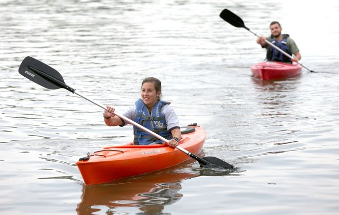 Donata Lorenzo of Cheektowaga and Ben Brown, right,  of Buffalo paddle rental kayaks from BFLO Harbor Kayaks  near Canalside. (Robert Kirkham/Buffalo News file photo)