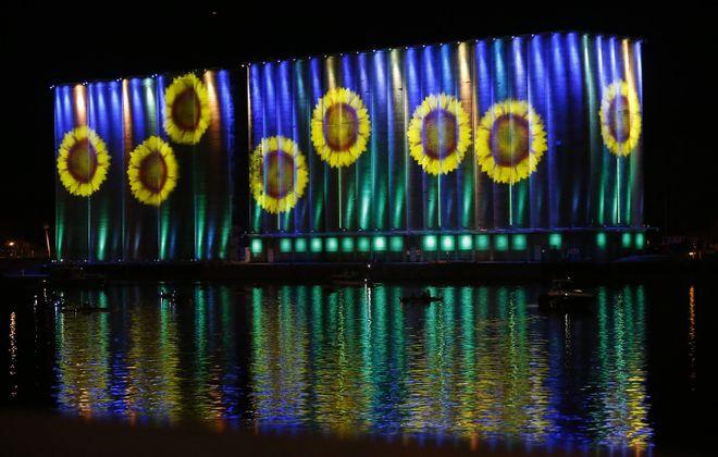 The illuminated grain elevators in 2015. (Mark Mulville/News file photo)