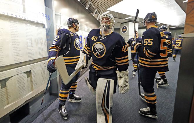 The Sabres' jerseys will have a new look starting Tuesday. (Harry Scull Jr./Buffalo News)