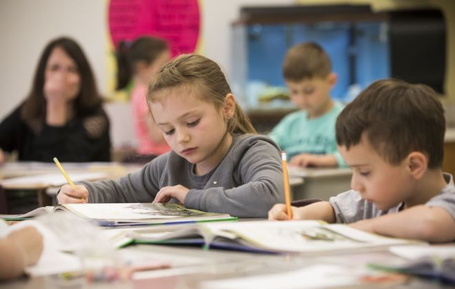 Emma Paradise and Jacob Lozada work on an  assignment in Terry Maida's first-grade class at Clinton Street Elementary School in West Seneca, Wednesday, May 10, 2017.  (Derek Gee/Buffalo News)