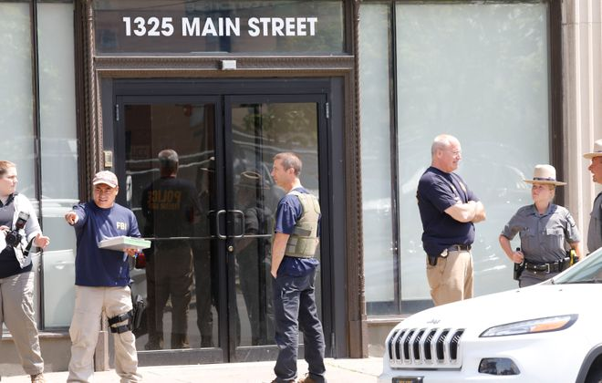 Federal agents emerge from 1325 Main St. after executing a search warrant, Thursday, June 15, 2017. (Derek Gee/Buffalo News)
