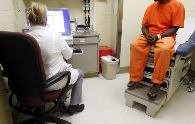 An inmate meets with a nurse at the Erie County Holding Center. (Mark Mulville/News file photo)