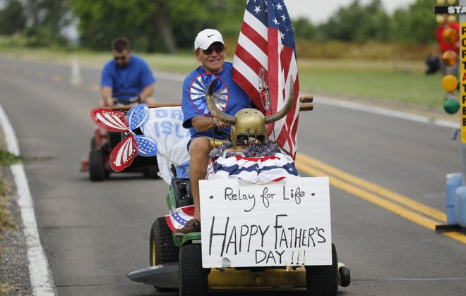 Jim Mazza has his lawnmower decked out for the annual Father's Day Lawn Mower Races on West River Parkway in Grand Island, Sunday, June 18, 2017.  (Derek Gee/Buffalo News)