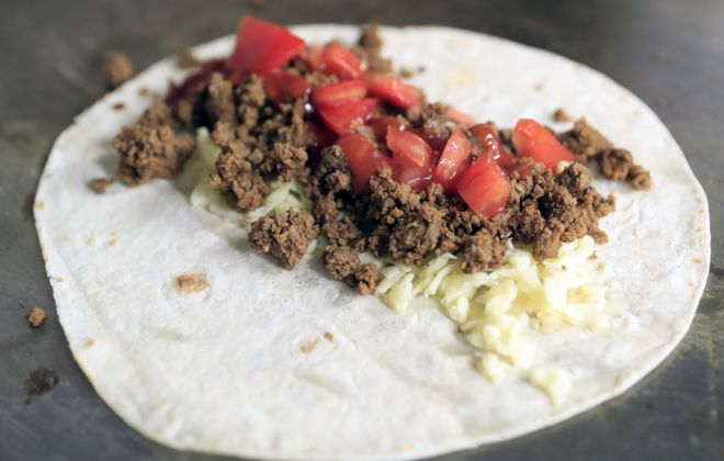 Ultima Taco  owner Dylan Biddeman makes a beef taco on Wednesday, June 21, 2017. (Harry Scull Jr./Buffalo News)