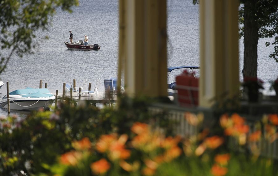 The natural beauty and peace at Chautauqua Institution are two reasons that thousands vacation there. Two men do some fishing on a relaxed afternoon on Chautauqua Lake.  (Sharon Cantillon/Buffalo News)