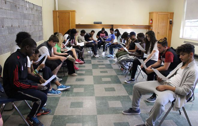 """Students from the theater program """"Shakespeare Comes to (716)"""" rehearse for their production of """"Romeo and Juliet."""" (Photo via Peace of the City)"""