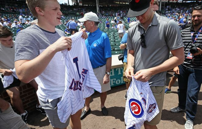 Sabres draft pick Casey Mittelstadt (L) and Gabriel Vilardi try on Cubs jerseys Wednesday at Wrigley Field (Getty Images)