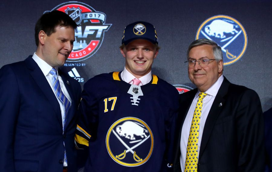 First-round pick Casey Mittelstadt joins GM Jason Botterill and owner Terry Pegula on the stage in Chicago (Getty Images).