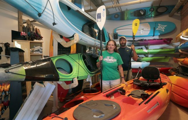 """""""I like to trick myself into working out. … And kayaking is awesome. Who doesn't like being on water? It's accessible. It's affordable."""" – Jason Mendola, who with Beth Bragg owns Elevator Alley Kayak Tours at The Barrel Factory, 65 Vandalia St., in the Old First Ward. (John Hickey/Buffalo News)"""