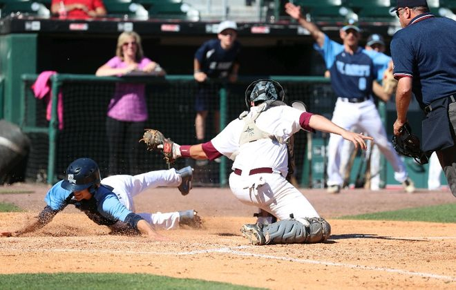 Alex Bish of St. Mary's, here shown trying to score, had an outstanding baseball season. (James P. McCoy/Buffalo News)