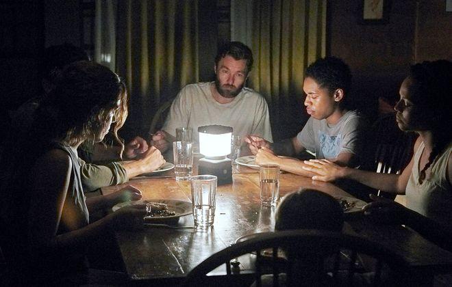 "Riley Keough, left, Christopher Abbott, Joel Edgerton, Kelvin Harrison Jr., Carmen Ejogo and Griffin Robert Faulkner in ""It Comes at Night."" (Eric McNatt, A24)"