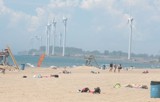 On too many days this year, sunbathing was all you could do at Woodlawn Beach State Park and other beaches in the area, thanks to high levels of contamination in the water. (John Hickey/Buffalo News)