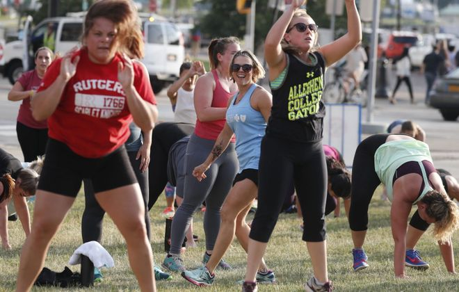 Stephanie Latawiec instructs a Blitz Body Bootcamp class, one of the weekly free outdoor summer events sponsored by Blue Cross and Blue Shield of WNY at Canalside. (Mark Mulville/Buffalo News)