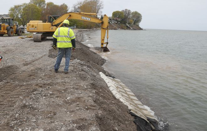 Niagara County Highway Department workers built up the shoreline in Olcott in May 2017 to protect against Lake Ontario's high water. (John Hickey/Buffalo News)