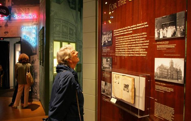 A visitor pauses to look at one of the exhibits in the Maltz Museum of Jewish Heritage outside of Cleveland. (Photo courtesy of Maltz Museum of Jewish Heritage)