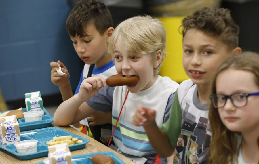 Third-grade students eat lunch in the cafeteria at Cayuga Heights Elementary School in Depew, Friday, June 9, 2017. From left are Tyler Halhab, 9, Nevan Walsh, 10, Cameron Christiano, 8, and Kristina Roy, 8. (Derek Gee/Buffalo News)