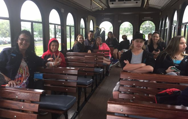 Visitors from Pittsburgh, Nebraska and Georgia filled driver Mike Gilbert's Discover Niagara Shuttle on a recent drizzly day. (Photo by Anne Neville)