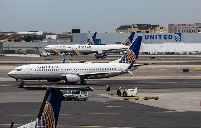 United Continental Holdings airplanes sit outside the company's hangar at Newark Liberty International Airport in Newark, New Jersey, on April  12, 2017. (Timothy Fadek/Bloomberg)