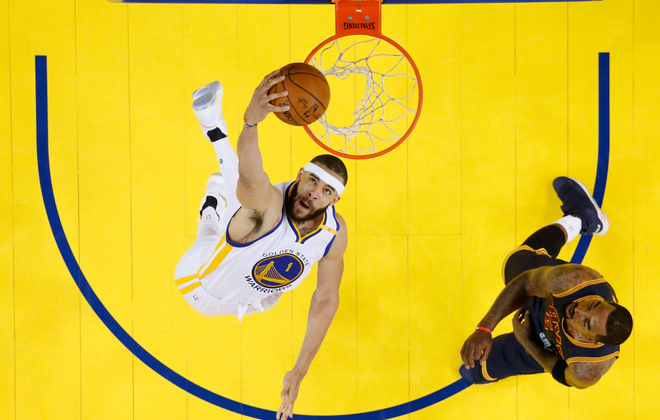 JaVale McGee of the Golden State Warriors dunks against Cleveland's JR Smith in Game One of the 2017 Finals. (Getty Images)