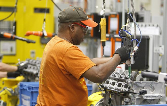An employee at work at the General Motors Powertrain Tonawanda Engine Plant. (News file photo)