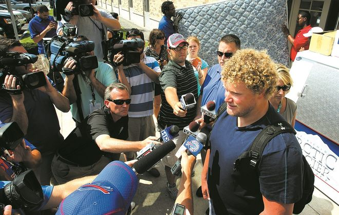Bills center Eric Wood talks to the media at training camp at St. John Fisher College in Pittsford. {James P. McCoy/News file photo)