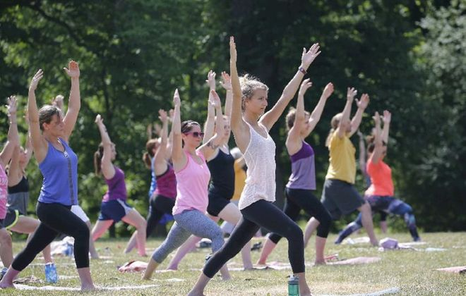 Yoga takes place at 10 a.m. Sundays on the lawn between the Delaware Park Rose Garden and Shakespeare Hill as part of the free Fitness in the Parks program, presented by Independent Health. (Derek Gee/Buffalo News file photo)