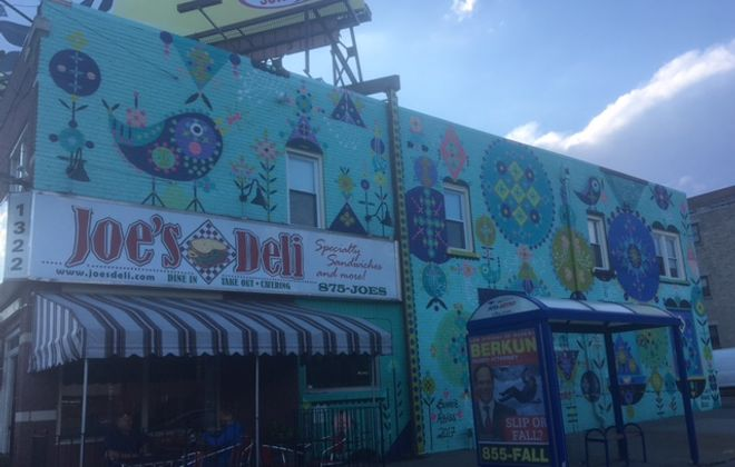 New mural unveiled recently on Hertel Avenue features dreamy images with geometrical and mythical themes. The mural is part of the Public Art Initiative.