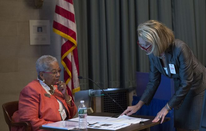 Attorney Jennifer Persico, right, presents documents to School Board President Barbara A. Seals Nevergold as she tries to discredit the board's stated reason for trying to remove Carl Paladino. (Photo: Mike Groll)