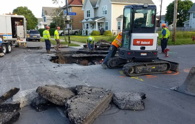 Buffalo crews on scene of road collapse at Pennsylvania Street and Busti Avenue on the city's West Side. (Harold McNeil/Buffalo News)