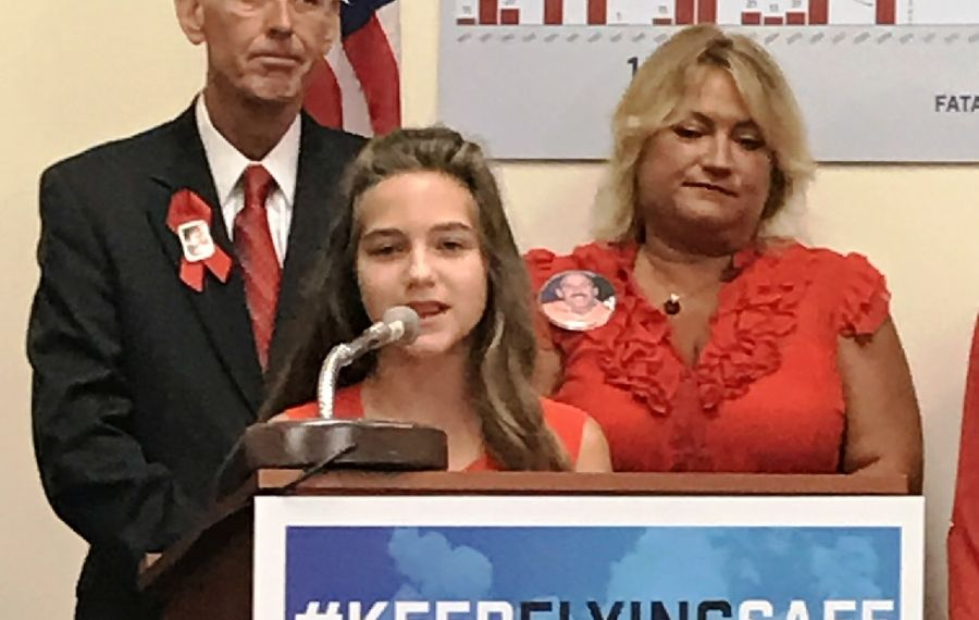 Caption: Ten-year-old Summer West discusses aviation safety on Capitol Hill Tuesday. She lost her father, Ernie West, in the 2009 crash of Continental Flight 3407 in Clarence. Behind her are Scott Maurer, a leading member of the families group, and Jennifer West, Summer's mother. (Jerry Zremski/The Buffalo News)