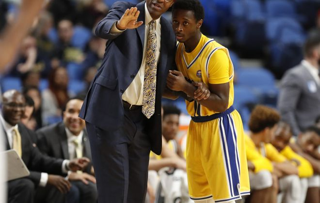 Canisius coach Reggie Witherspoon talks with guard Malik Johnson during a break against the University at Buffalo at the Big 4 classic at KeyBank Center on Saturday, Dec. 17, 2016. (Harry Scull Jr./News file photo)