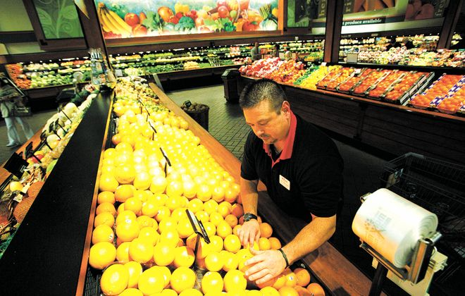 Produce Manager Jeff Morgano at Tops Friendly Markets on Transit Road in Depew in 2012. Suppliers and vendors appear most frequently on the list of Tops' largest creditors. (Derek Gee/Buffalo News file photo)