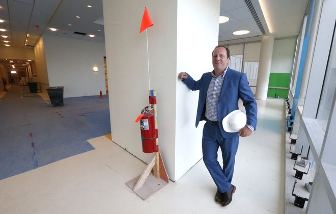 Scott Propeack, volunteer art curator at Oishei Children's Hospital and co-director at Burchfield Penney Art Center. He is helping to curate art that will go into the new Children's Hospital when it opens later this year.  (Robert Kirkham/Buffalo News)