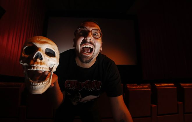 """Peter Vullo serves as the programmer and host of the """"Thursday Night Terrors"""" film series at Dipson Amherst Theatre. (Sharon Cantillon/Buffalo News)"""