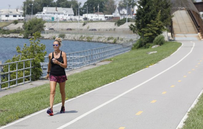 Pattie Kerl of Akron walks along the Shoreline Trail, which runs along the Niagara River in Riverside.   (Derek Gee/Buffalo News)