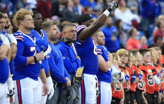 Buffalo Bills Cameron Jefferson raises his right hand during the National Anthem prior to playing the Detroit Lions at New Era Field on Thursday, Aug. 31, 2017.(Harry Scull Jr./Buffalo News)