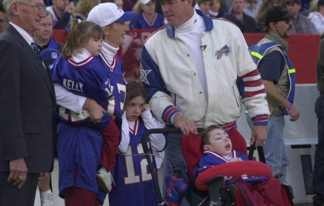 Jim Kelly's late father Joe Kelly , Jim Kelly's wife Jill with daughter Camryn in her arms, Erin , 6, and  former Buffalo Bills quarterback Jim Kelly , and his son Hunter, 5,   on Nov. 18, 2001. (John Hickey/Buffalo News)