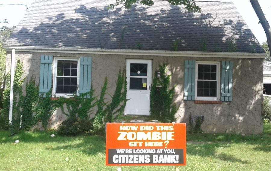 "This vacant house at 8220 Frontier Ave., seen on Aug. 25, 2017, is one of the Citizens Bank ""zombie homes"" posted by Niagara Falls workers, which led to a successful lawsuit against the bank. (Thomas J. Prohaska/Buffalo News)"