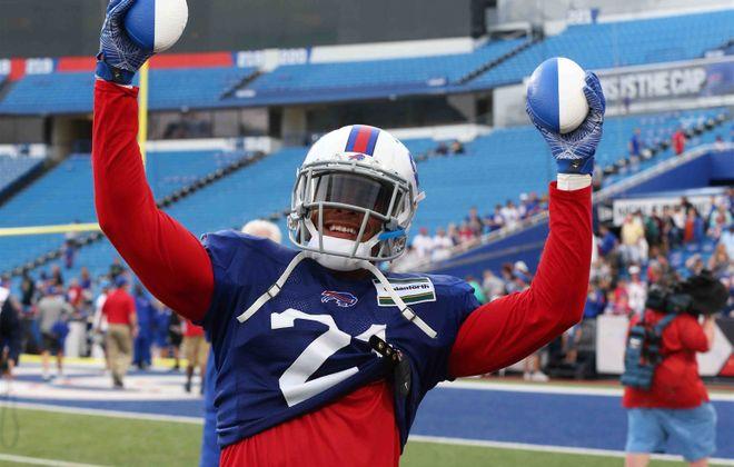 Jordan Poyer has some freebies for fans at Bills practice. (James P. McCoy/Buffalo News)