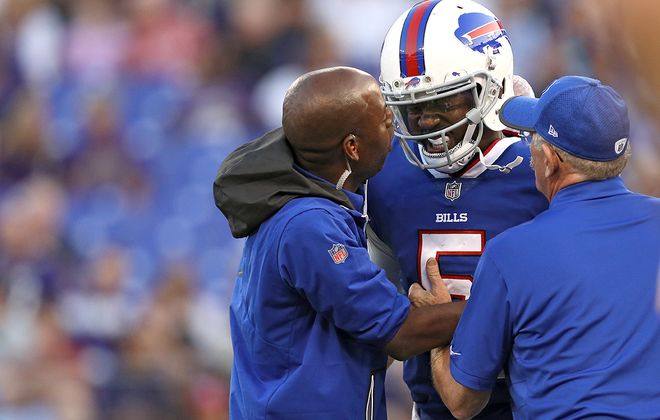 Bills QB Tyrod Taylor reacts after being sacked against the Baltimore Ravens in the first quarter on Aug. 26 in Baltimore. (Patrick Smith/Getty Images)