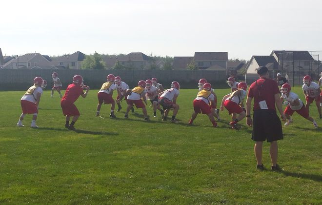 Defending Section VI Class AA football champion Lancaster holds practice Monday morning. (Miguel Rodriguez/Buffalo News)