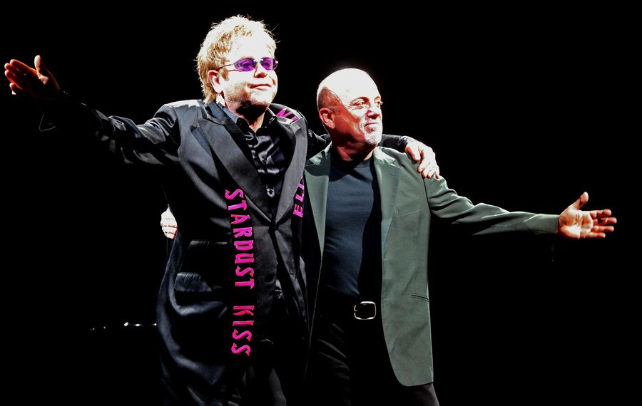 Elton John and Billy Joel take to the stage for their long-delayed 2010 show. (Robert Kirkham/News file photo)